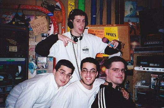 Eric's brother Paul at his college radio station with friends