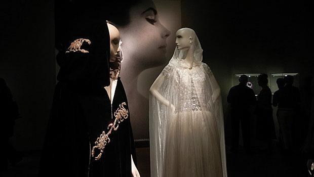 "Taylor wore this Tiziani black velvet evening cape (L) to Princess Grace of Monaco's 40th birthday ""Scorpio Ball"" and this Chanel ballgown (R) to 'The Taming of the Shrew' in 1967 in London."