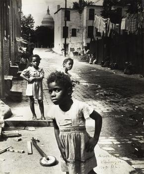 The photographers also treated their cameras as tools of social change. Shown here: a work by Marion Palfi, who captured these children playing in a grim alley in the shadow of the Capitol, 1948.
