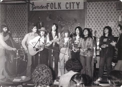 A group song at Gerdes, featuring Mark Dann, Lucinda Williams, James Humphrey, Marie Gabrielle, Bernadette Contreras, Karan Bunin and Jeff Ampolsk.