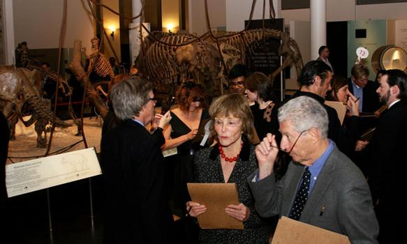 Guests try to work their way through Stephen Sondheim's treasure hunt at the Natural History Museum.