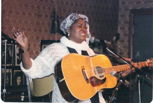 Odetta performs on stage at Gerdes Folk City.