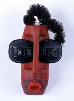 Nearby, in the Met's African sculpture galleries, there is a new show devoted to contemporary works inspired by mask-making. Above, the piece 'Ear Splitting,' by Roald Hazoumé, from Benin.