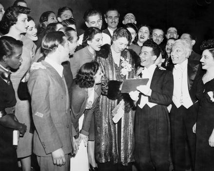 "Performers look on as Al Levy, a ""Pins & Needles"" performer, gets the autograph of Eleanor Roosevelt following the performance at the Labor Stage, November 1945."