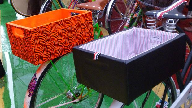 Nicole Miller's orange rear bike box alongside Thom Browne's stripey one.