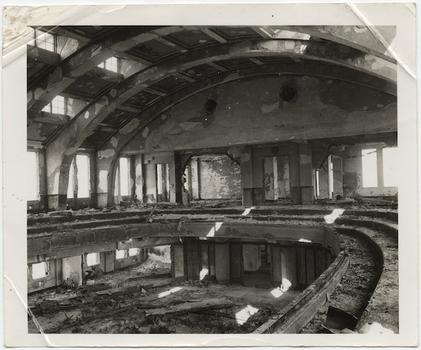 [Interior of Hiroshima City Hall auditorium with undamaged walls and framing but spalling of plaster and complete destruction of contents by fire], November 1, 1945.