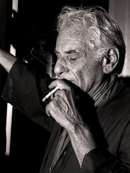 Leonard Bernstein smokes a cigarette at Avery Fisher Hall, June 24, 1988.