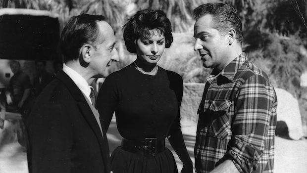 "Leonard Lyons with Sophia Loren and Rossano Brazzi in Libya on the set of ""Legend of the Lost."" Loren kept warm in the cold desert night by using my father's extra pair of woolen pajamas."