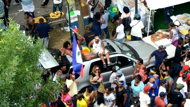 Revelers hung out on cars to catch a glimpse of the parade.
