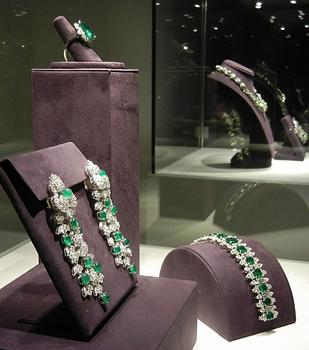 A pair of Kutchinsky emerald and diamond ear pendants along with more gifts from Richard Burton: a Bulgari emerald and diamond bracelet and ring.