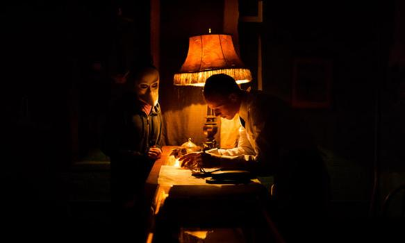 "Castmember John Sorensen-Jolink in a vintage room in ""Sleep No More."""