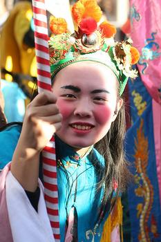 A parade-goer at a recent Chinese New Year celebration in Paris