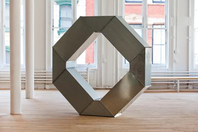 Charlotte Posenenske's metal tubes have been scrambled into an array of geometric forms over the last month and a half. Above, a piece configured by the staff at Artists Space.