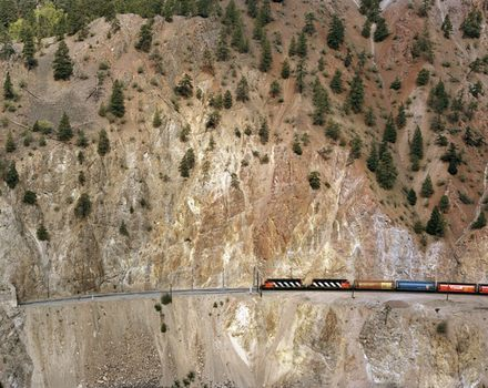 """Railcuts #6 (red hill, C.N. train)"" was taken on the C.N. track on the Thompson River in British Columbia in 1985."