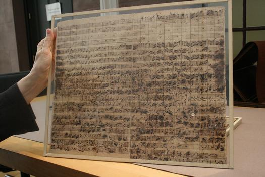 Lehman Collection curator Frances Barulich shows off a page of cantata 171. The nearly 300-year-old manuscript is kept under glass.