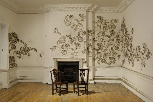 Using dust and a little glue, Catherine Bertola crafts elaborate Victorian-style patterns on the museum's walls. The installation shown above is from 2006.