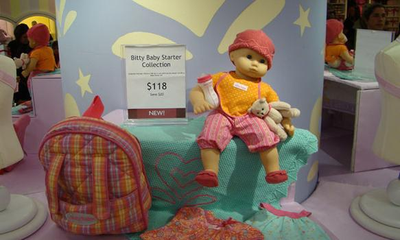 The Bitty Baby Starter Collection at the American Girl store costs $118.