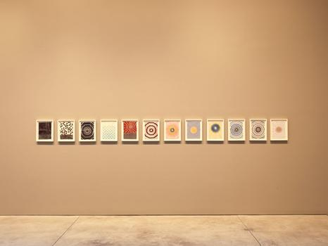 From a distance, the works look like watercolors or paintings. Only on closer inspection do they reveal their material. Shown here: an installation view of the exhibit.
