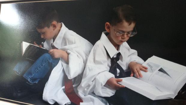 Photograph of Brian Gestring's sons pretending to study forensic science - a gift from his wife.