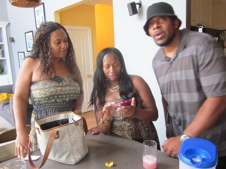 Shameca Hines, Jeannine Crump and Carlos Encarnacion in Jeannine's kitchen
