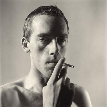 """Peter Hujar's """"David Wojnarowicz Smoking,"""" a gelatin silver print taken in 1981, is one of the photos in the show currently on view at the Matthew Marks Gallery."""