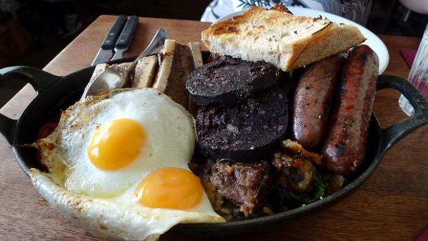 English Breakfast isn't just a type of black tea. Seen here, a traditional English breakfast including eggs, black pudding, toast and sausage. Vegetarians beware.