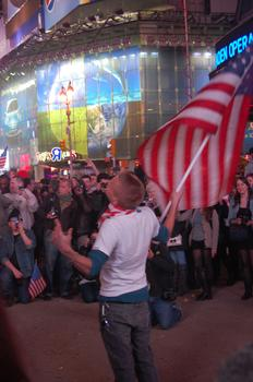 One young man waving a large flag and sporting an American flag handkerchief lead many of the cheers.