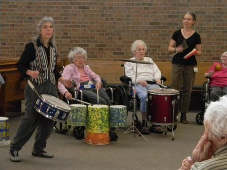 Fre Atlast (left) leads the drum circle with Marci Berman, an occupational therapist  (right).