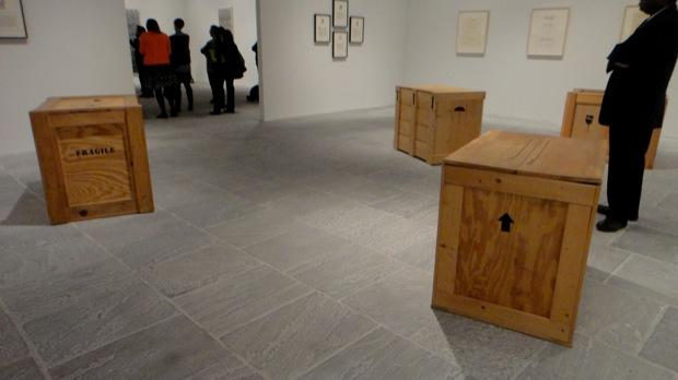 Some of the most powerful pieces in Ligon's show are these wood crates — which are the same dimensions as the crate that the slave Henry 'Box' Brown used to mail himself to freedom.