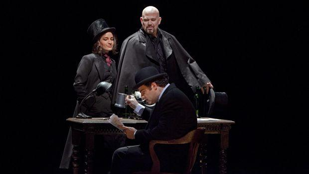 "A scene from Act II (Antonia act) of Offenbach's ""Les Contes d'Hoffmann""  with Joseph Calleja as Hoffmann (seated), Kate Lindsey as Nicklausse, and Alan Held as Dr. Miracle."