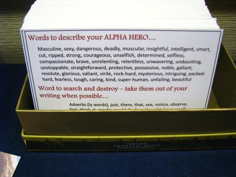"A notecard to help writers use good key words in describing their male heroes. The phrase ""beer-gut"" is nowhere to be seen."
