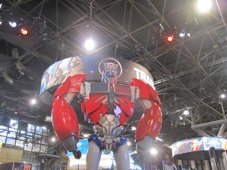 A giant Transformer looms over the show floor.