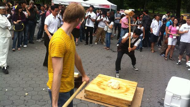 Guests were invited to pound rice into dough with giant mallets.