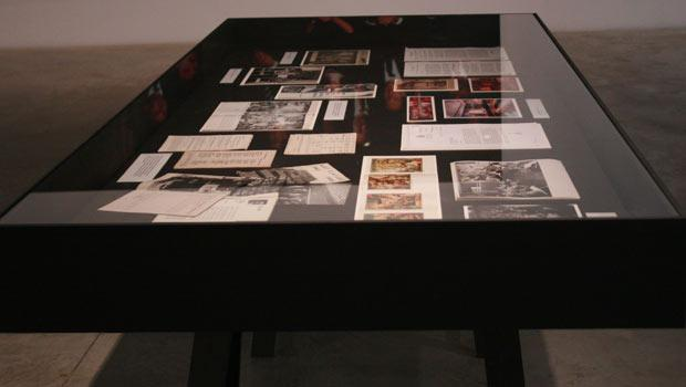 Two tables featuring documents and other papers that not only tell the story of The New School's acquisition of the Egas mural but also the history of the university itself.