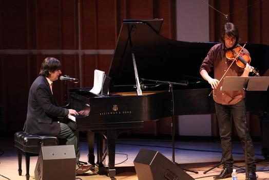 John Darnielle and the violinist/composer Owen Pallett, who created the arrangements of Darnielle's song cycle <em>Transcendental Youth.</em>