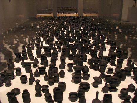 'Throwing Shadows,' one of LeDray's most recent works, is composed of 3,000 diminutive black porcelain pots. Most of these are no bigger than my thumb.