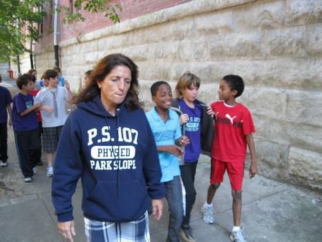 Diane DiTonne-Gihuley, the gym teacher at PS107, escorts the 5th grade class