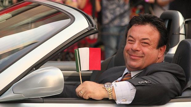 Luxury cars and Italian flags were two items that appeared in large quantities along Fifth Avenue on Monday