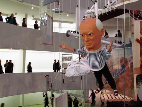 Because no installation is complete without a giant floating Picasso doll. (A sculpture from 1998.)