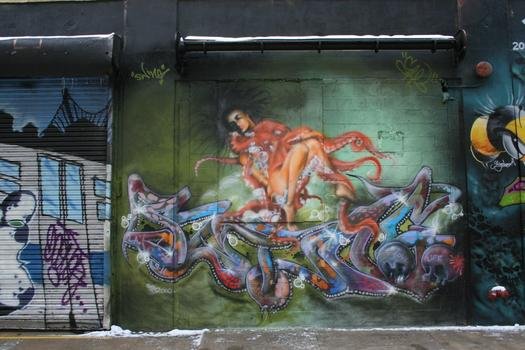 Grafitti is legal on the building's facade, which constantly changes as artists paint over old artwork.