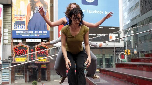 Shen Wei Dance Arts dancers in a balancing act