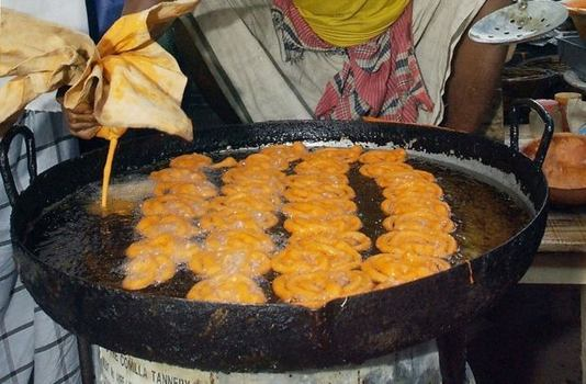 Jalebi, an orange pretzel-shaped pastry filled with sweet syrup, is an Eid favorite.