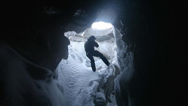 Above, a still from Biggs' 'In the Cold Edge' at Winkleman Gallery — in which the artist follows an explorer into an icy Arctic cave.