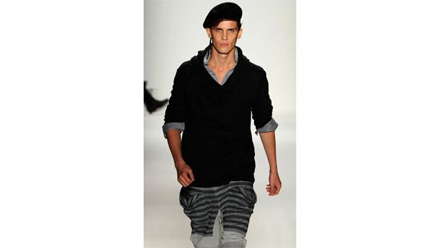 September 9, DAY 1: A male model marches to the beat of his baret at the the NIcholas K presentation.