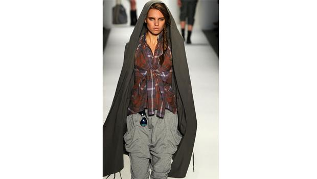 September 9, DAY 1: A model wears the most splendid cape you ever did see on the Nicholas K runway.