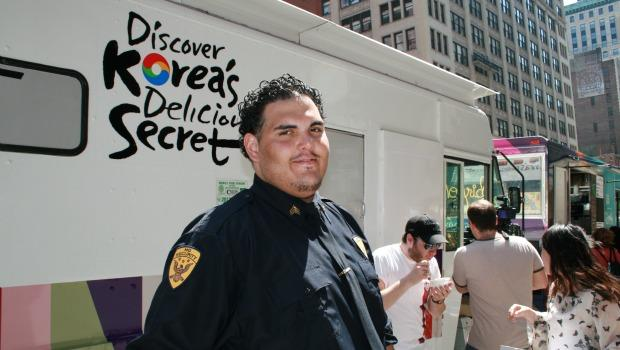 David Rodriguez is employed by a Taste of Korea food truck to mind the lines that are sometimes 50 people long.