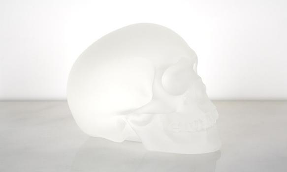 "This piece called ""Crystal Skull 1-12"" is made of cast glass."