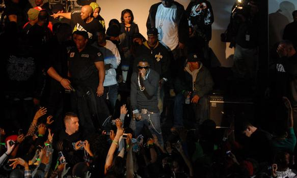 Weezy (center) performs for the crowd.