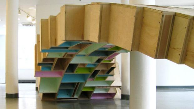 Louis Lim's project is a bridge made from plywood boxes that interacts with the architecture of the Cooper Union foundation building.