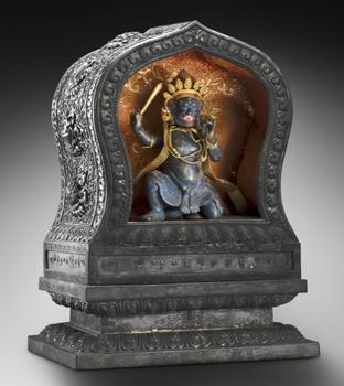 Also part of the Met's exhibit: This carved stone shrine to a Tibetan Buddhist guardian deity.